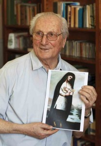 Fr. Paolo Molinari, postulator for the sainthood cause of St. Kateri Tekakwitha, holds a copy of a portrait of Kateri, painted by Fr. Claude Chauchetière in 1696 (CNS photo).