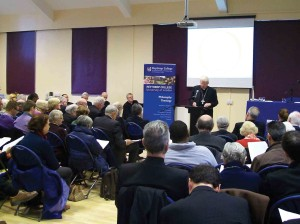 The public meeting at Heythrop College on the afternoon of the same day.