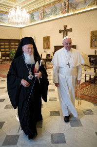 Pope Francis walks with Ecumenical Patriarch Bartholomew of Constantinople at the Vatican on March 20 (CNS photo).