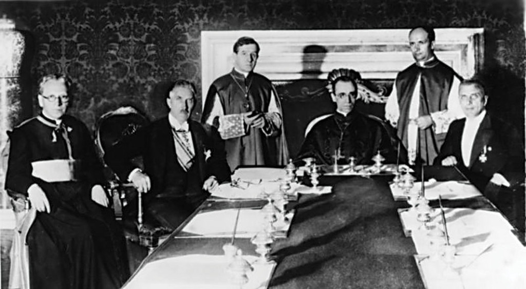 The signing of the Reichskonkordat between the Holy See and Germany on July 20, 1933, in Rome. (From left to right: German prelate Ludwig Kaas, German Vice-Chancellor Franz von Papen, Secretary of Extraordinary Ecclesiastical Affairs Giuseppe Pizzardo, Cardinal Secretary of State Eugenio Pacelli, then-Monsignor (later Cardinal) Alfredo Ottaviani, and member of Reichsministerium des Inneren (Home Office) Rudolf Buttmann.