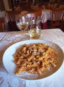 Fusilli (corkscrews) alla califfa, with bacon, mushrooms, pachino tomatoes, basil, parsley and cream.