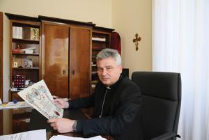 Archbishop Konrad Krajewski, Vatican Almoner, in his office.