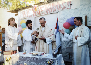 Pope Francis, as bishop, is seen celebrating Mass at the Villa 21-24 slum in Buenos Aires, Argentina, in 1998. Padre Pepe (without a beard) is the first one on the left.