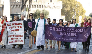 Maryknoll Father Roy Bourgeois, a U.S. priest who faces possible dismissal from his order and the priesthood for support of women's ordination, marches down Via della Conciliazione toward the Vatican during a demonstration in Rome Oct. 17