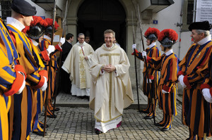 Msgr. de Raemy among the Swiss Guards leaves  St. Nicholas' Cathedral for his consecration.