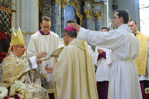 Newly-consecrated Bishop de Raemy receives the zucchetto.