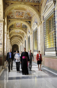 Msgr. Alain de Raemy leads the new recruits' parents into the Apostolic Palace to a meeting  with the Holy Father.