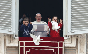Pope Francis with the two Ukrainian children who released the doves in St. Peter's Square.
