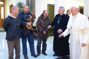 Pope Francis, Archbishop Konrad Krajewski and three homeless men, invited by the pontiff to have breakfast with him on the day of his birthday.