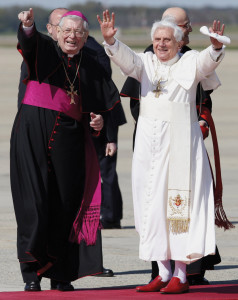 Pope Benedict XVI waves beside Archbishop Pietro Sambi, apostolic nuncio to the United States, after arriving at Andrews Air Force Base outside Washington on April 15, 2008.