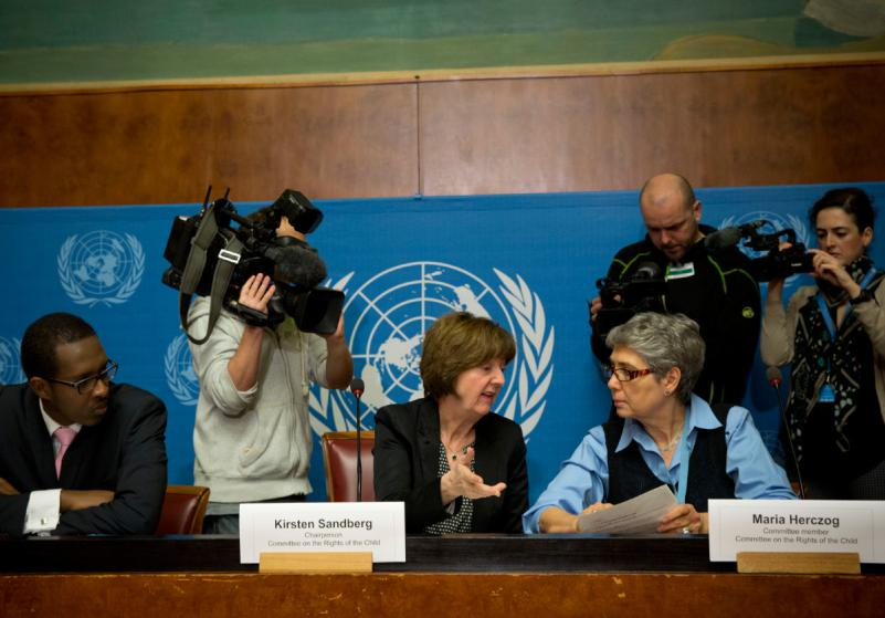 Kirsten Sandberg, center, chairperson of the U.N. human rights committee on the rights of the child, talks to committee members Maria Herczog, right, and Benyam Mezmur during a press conference at the United Nations headquarters in Geneva, Switzerland, Wednesday, February 5, 2014. A U.N. human rights committee denounced the Vatican on Wednesday for adopting policies that allowed priests to rape and molest tens of thousands of children over decades, and urged it to open its files on the pedophiles and the churchmen who concealed their crimes. (AP Photo/Anja Niedringhaus)