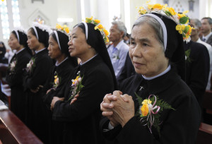 Nuns attend a Mass for the profession of vows for the Lovers of the Holy Cross of Hung Hoa Sisters in Son Tay, Vietnam, October 29, 2011. Vietnam has the second-largest Catholic community in Southeast Asia, after the Philippines (CNS photo)