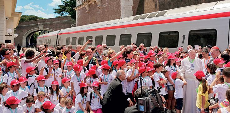 "June 23, 2013. At the Vatican City train station (""Stazione Ferroviaria Vaticana""). Pope Francis with Cardinal Ravasi and his personal secretary don Alfred Xuereb greet the young people who are arriving on the ""Children's Train"" on ""a journey through beauty"" (""Treno dei Bambini: Un Viaggio attraverso la Bellezza"")"