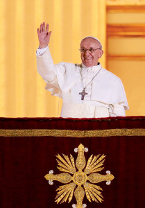 In March 2013, the new Pope appears for the first time on the balcony of St. Peter's Basilica and asks the people of Rome, and the world, to pray for him.