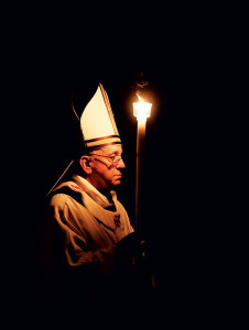 March 13, 2013.  St. Peter's Basilica. Holy Saturday. Easter Vigil Mass celebrated by Pope Francis. The Holy Father is walking toward the altar holding a single candle.