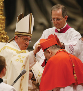 Pope Francis imposes the red berretta on the head of Cardinal Pietro Parolin, Titular Archbishop of Acquapendente and Vatican Secretary of State. In the background, Mons. Guido Marini (Galazka photo).