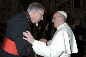 Cardinal George Pell of Sydney greets Pope Francis during his audience with cardinals March 15, 2013, at the Vatican. (CNS photo/L'Osservatore Romano).