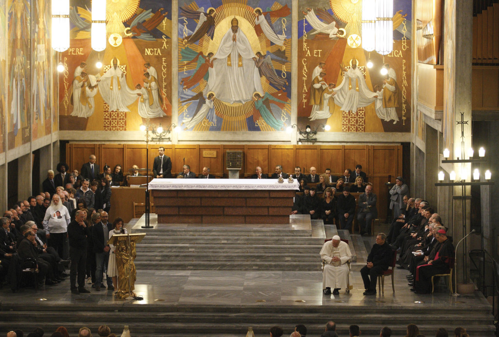 Pope Francis bows his head as people read the names of Mafia victims during a prayer service at the Church on March 21.