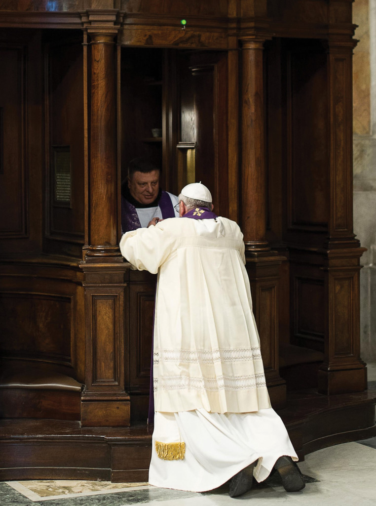 A priest hears Pope Francis' confession during a penitential liturgy in St. Peter's Basilica at the Vatican March 28. Pope Francis surprised his liturgical adviser by going to confession during the service.