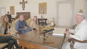 The Pope conversing with children from Belgium.