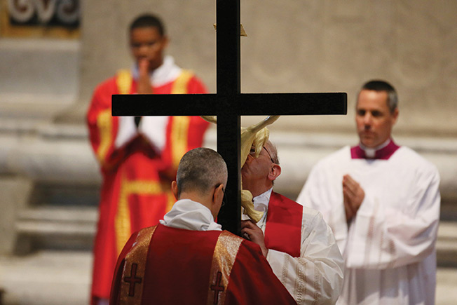 In St. Peter's Basilica on Good Friday in the early evening, Pope Francis celebrated the memory of the Lord's Passion by venerating the  Holy Cross.