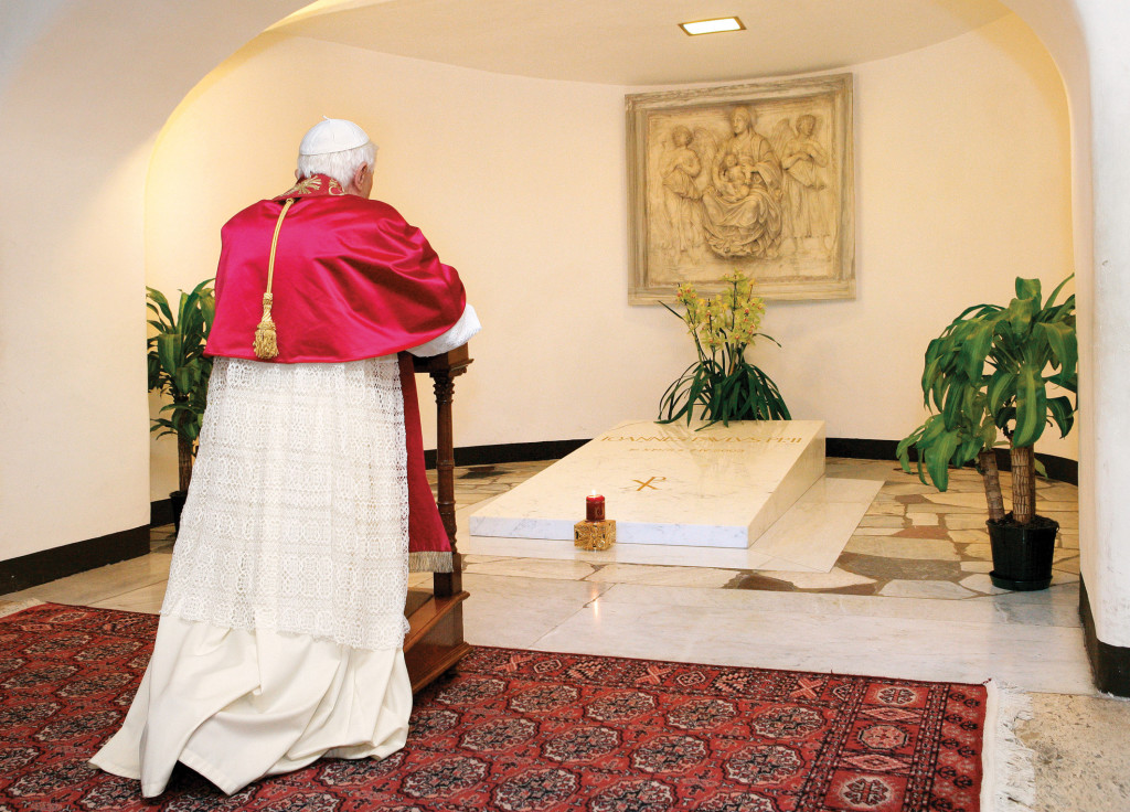 On November 2, 2005, a few months after his election as Pope, Benedict XVI knelt in prayer before the tomb of Pope John Paul II on All Soul's Day.