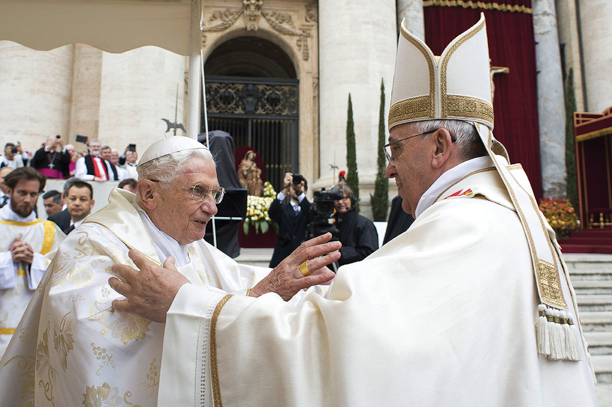 Retired Pope Benedict XVI embraces Pope Francis before the canonization Mass for Sts. John XXIII and John Paul II in St. Peter's Square at the Vatican April 27. It was Benedict's first public appearance in a liturgy since his resignation in February 2013 (CNS photo).