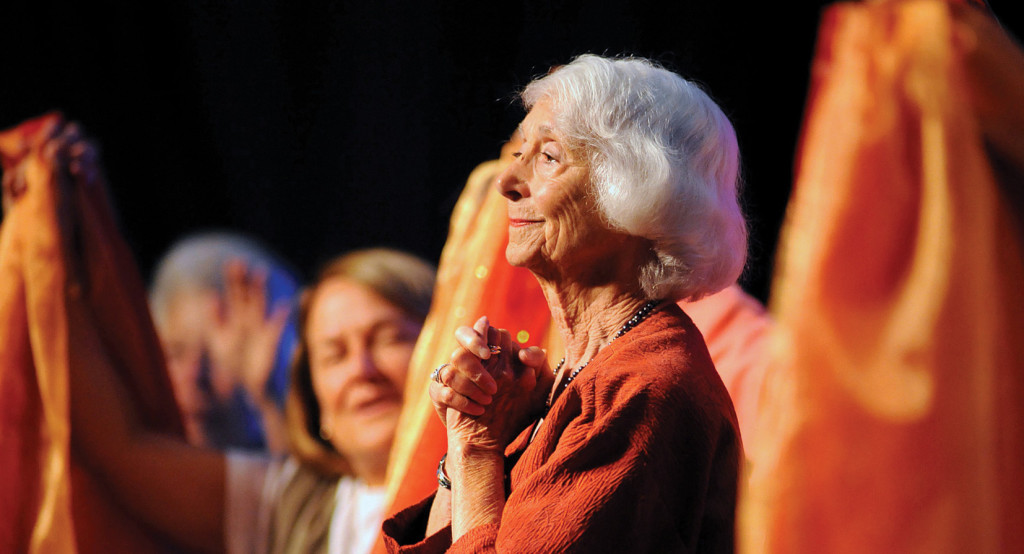 """Right, keynote speaker Barbara Marx Hubbard smiles on August 8, 2012 as she is greeted by delegates at the annual assembly of the Leadership Conference of Women Religious in St. Louis. She spoke on """"The Transformation of Consciousness and Religious Life Leadership"""" (CNS photo)."""