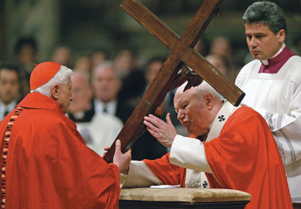 Good Friday, April 9, 2004, a year before St. John Paul II died. The aging Pope receives the cross from then-Cardinal Joseph Ratzinger.