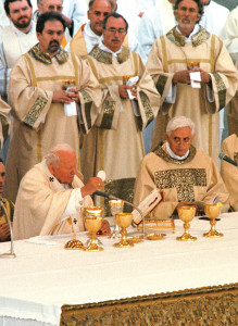 On June 25, 2000, in St. Peter's Square, St. John Paul II closed the International Eucharistic Congress, flanked by then-Cardinal Joseph Ratzinger at the moment of Consecration.