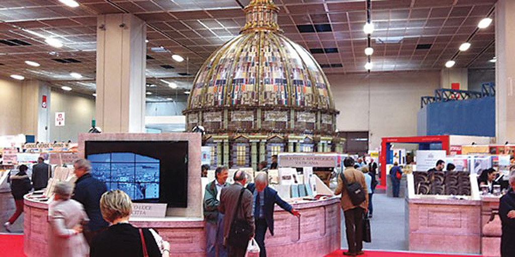 "The unusual Vatican Press book display centered on a ""cupola of books"" in the shape of Michelangelo's cupola above St. Peter's Basilica."