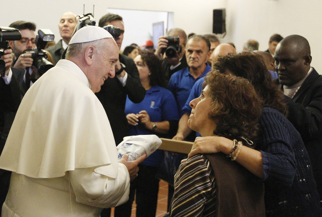 """Pope Francis leads a meeting with the poor in the archbishop's residence in Assisi, Italy, October 4, 2013. The meeting was in the famous """"stripping room,"""" where St. Francis stripped off his rich clothes, gave them to his father and began a life of poverty dedicated to Christ (CNS photo/Paul Haring)."""