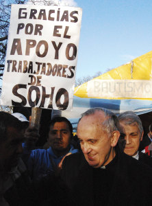 "Pope Francis with protesters in Buenos Aires, Argentina in 2011. The sign reads ""Thanks for supporting the laborers of Soho clothing factory""."