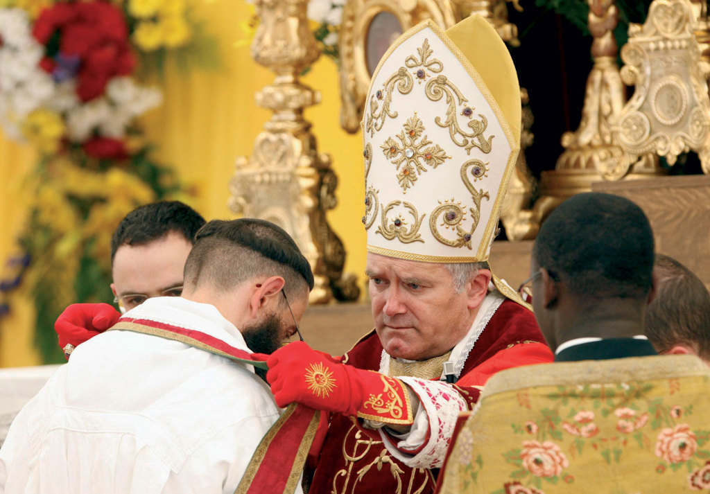 "Bishop Bernard Fellay, superior of the society of St. Pius XI, ordains a priest during a ceremony in Econe, Switzerland. The Vatican has said it considers such ordinators ""illegitimate, although the priests are validly ordained. In 2009,   Pope Benedict XVI lifted the excommunication of Bishop Fellay and three other bishops of the traditional society."