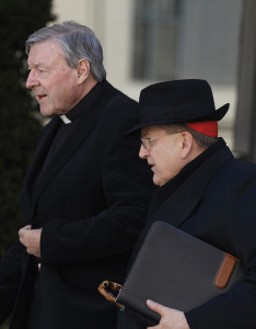 Cardinal Burke, right, and Cardinal Pell, left.