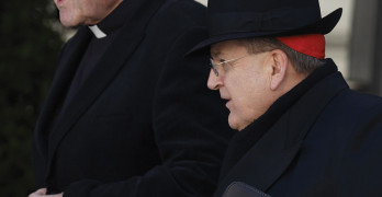 Cardinal Burke, right, and Cardinal Pell, left.