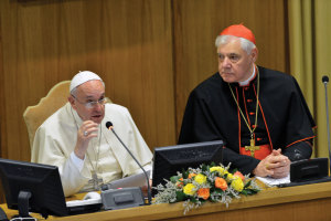 Francis at the conference with Cardinal Mueller, who sponsored it.