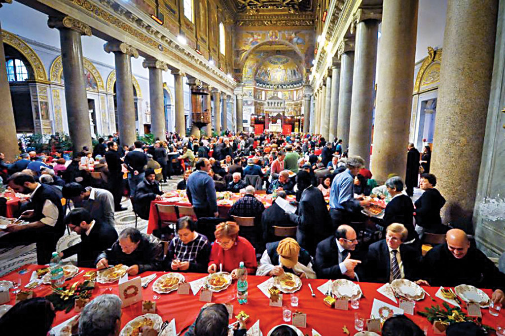The traditional Christmas meal in the Basilica of Santa Maria in Trastevere offered to Rome's poor by the Sant'Egidio Community .