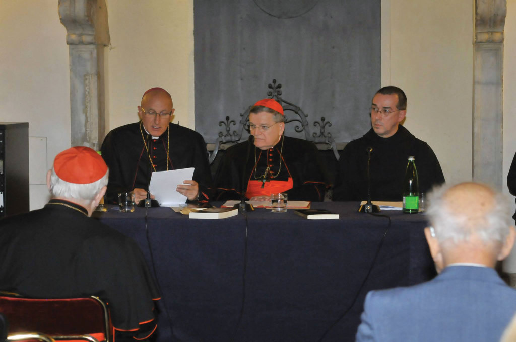 American Cardinal Raymond Burke (center), together with Bishop Dominique Rey of Frejus-Toulon, France (left) and Dom Alcuin Reid, a monk at the monastery of St. Benedict in Frejus-Toulon, at the presentation of a volume on the liturgy at the Columbus Hotel in Rome on November 21.