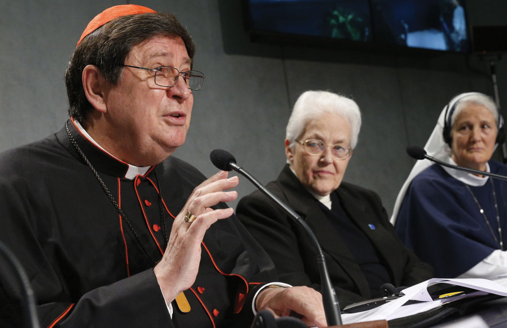 Brazilian Cardinal Joao Braz de Aviz, Prefec of the Congregation for Institutes of Consecrated Life and Societies of Apostolic Life, speaks at Sister Sharon Holland, president of the Leadership Conference of Women Religious, listen during a December 16 Vatican press conference releasing the final report of a Vatican-ordered investigation of US communities of nuns.