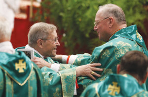 "An embrace between a ""progressive"" and a ""conservative"": Cardinal Walter Kasper and Cardinal Timothy Dolan of New York."