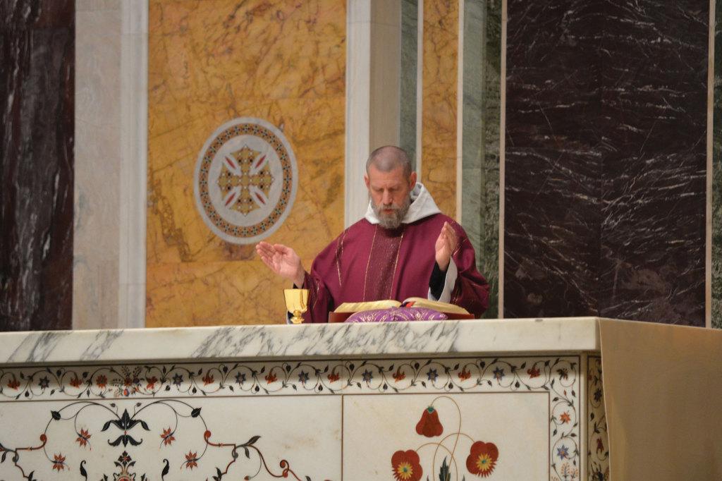Father Cassian Folsom from Norcia, Italy, celebrated the opening Mass in St. Matthew's Cathedral on December 10.
