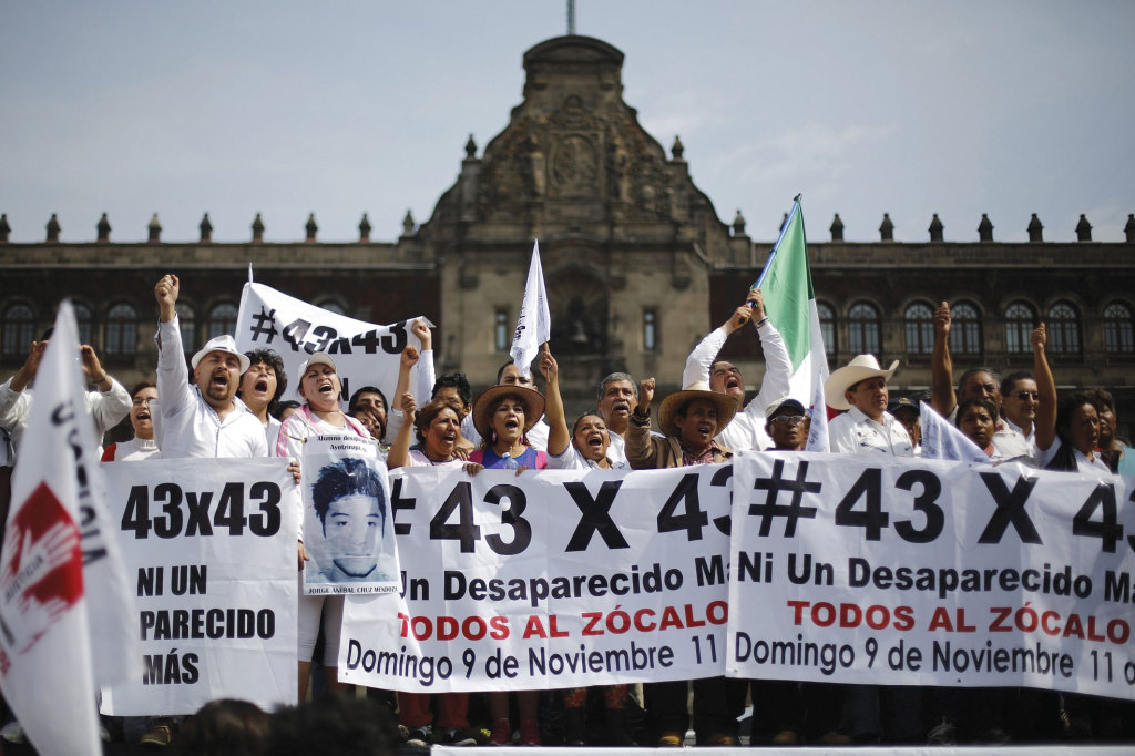 People taking part in a protest to demand more information about the 43 missing students.