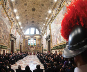 A Swiss Guard keeps watch as Pope Francis speaks during an audience with the Vatican diplomatic corps.