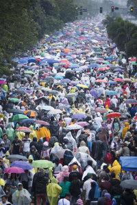 Pilgrims walk down Roxas Boulevard in Manila, Philippines.