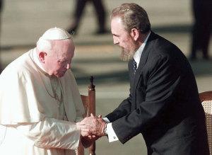 Pope John Paul II greets Fidel Castro in Havana on January 25, 1998.