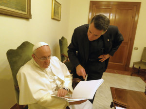 """Monsignor Checchio explaining the design plans for """"The Tower"""" to Pope Francis."""