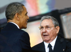 US President Barack Obama greets Cuban President Raul Castro (Fidel's brother) before giving his speech at a memorial service on December 10 for late South African President Nelson Mandela.