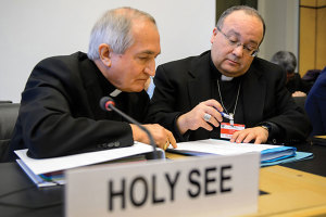 Vatican's UN ambassador Monsignor Silvano Tomasi speaks with former Vatican Chief Prosecutor of Clerical Sexual Abuse, Charles Scicluna (right).