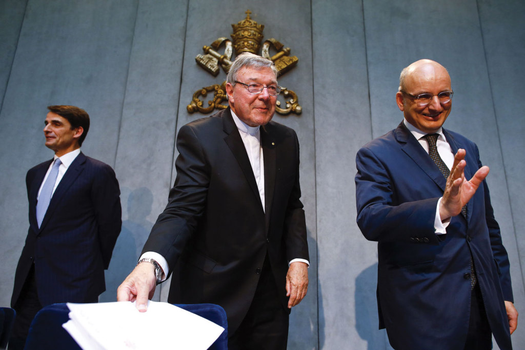 Jean-Baptiste de Franssu, left, new President of the Vatican Bank, outgoing President Ernest Von freyberg, and Australian Cardinal George Pell, at the Vatican on July 9 2014.